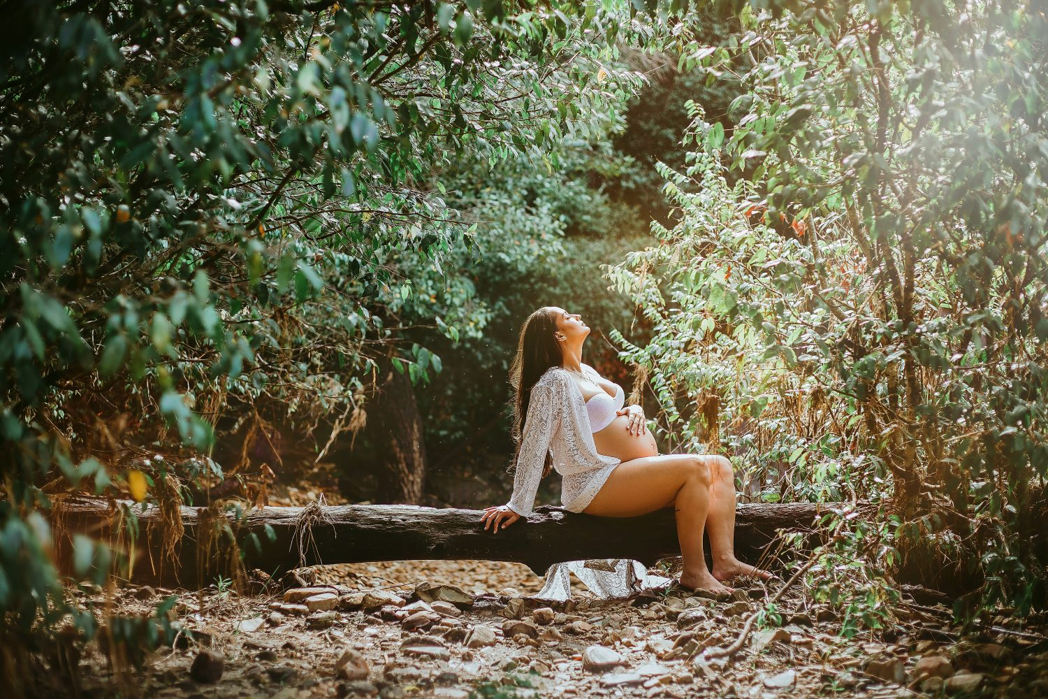 Pregnant woman relaxing in the forest.