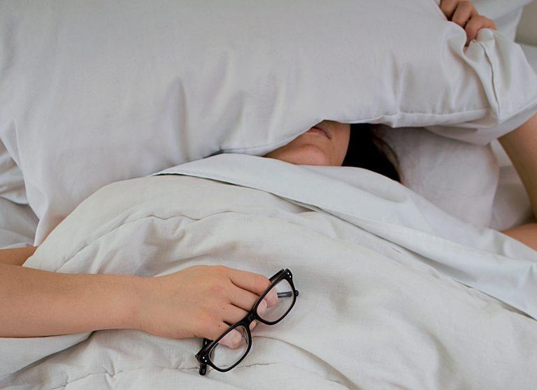 Sleepy woman in bed
