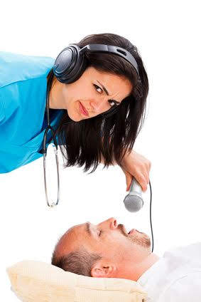 Doctor lady listening to a sleeping man's snoring - disturbing snoring concept.
