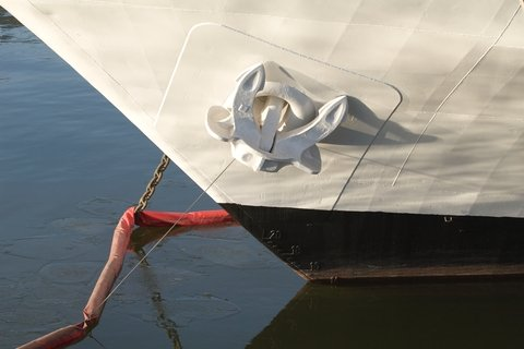 The nose of the ship white, on-berth at anchor
