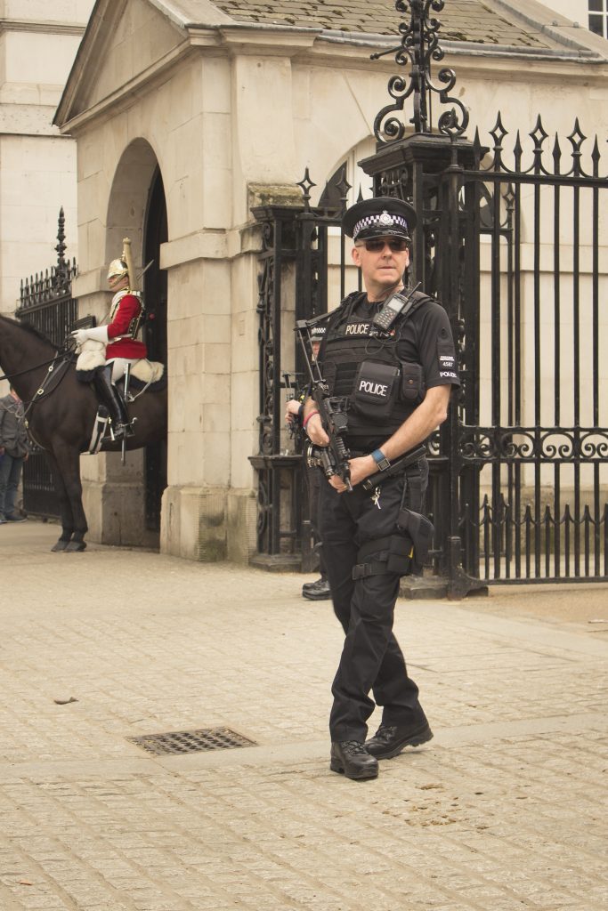 Policeman with gun - symbol for Wei qi