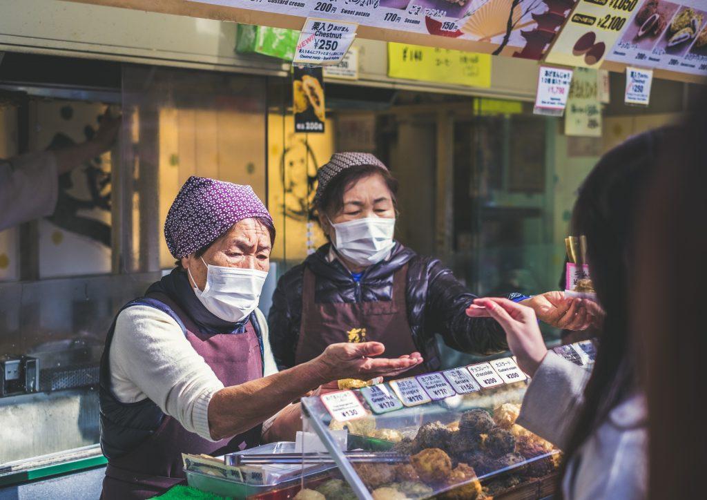 Stall vendors wearing masks