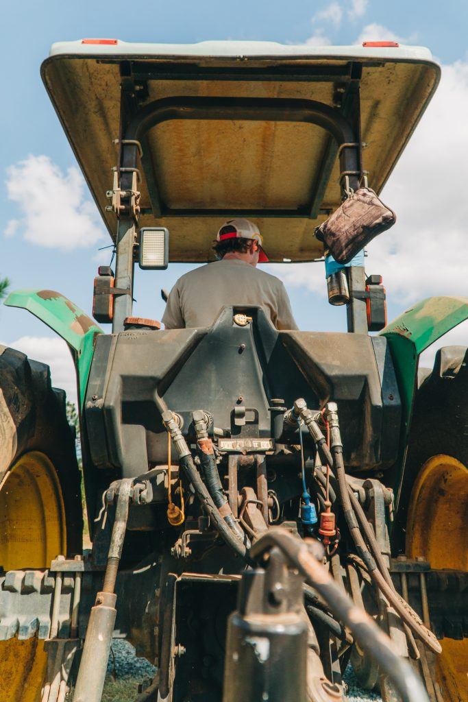 Crop spraying tractor: supplements for the soil