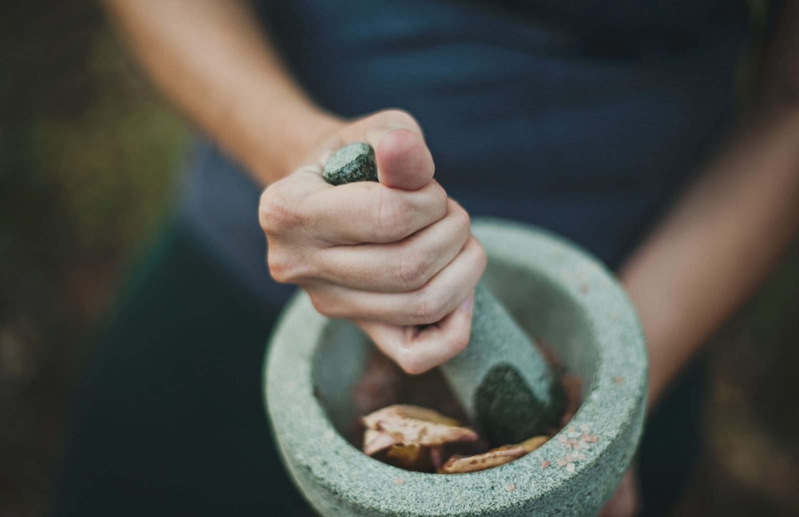 Grinding chinese herbs with mortar and pestle